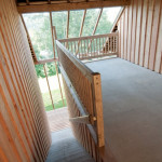 Design holiday Houses Rajsko - covered porch with view to Otava river valley devides 2 apartments