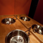 bathroom - 2 stainless steel sinks set into wooden board