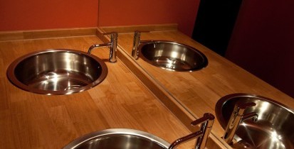 bathroom - 2 stainless steel sinks set into wooden board